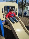 Moving down the slide on the playground
