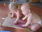 Cole and Norah paint the inside of a box