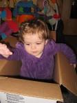 Rebecca explores an empty box in the classroom