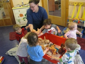 Key Developmental Indicators: Exploring objects and filling and emptying.